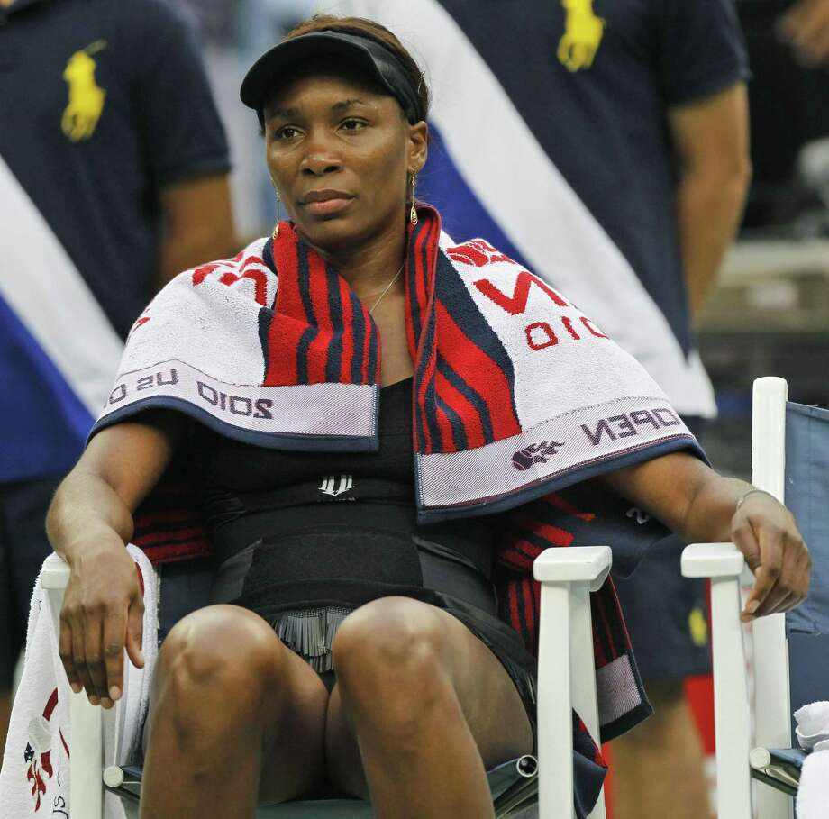 Venus Williams of the United States sits in her chair during her match against Kim Clijsters of Belgium in the semifinal round of play at the U.S. Open tennis tournament in New York, Friday.  (AP Photo/Mark Humphrey) Photo: ASSOCIATED PRESS / AP