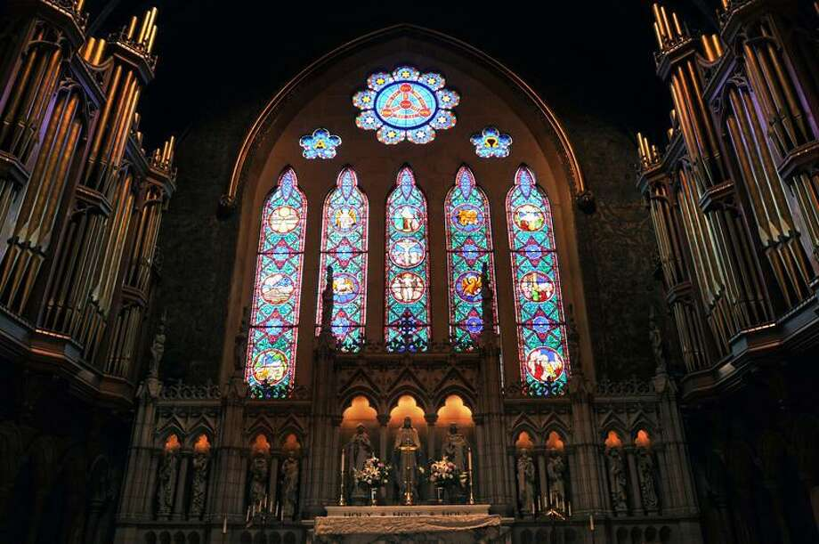 The stained glass Trinity window behind the altar at Trinity Episcopal Church on the Green.  (Peter Casolino/Journal Register News Service)