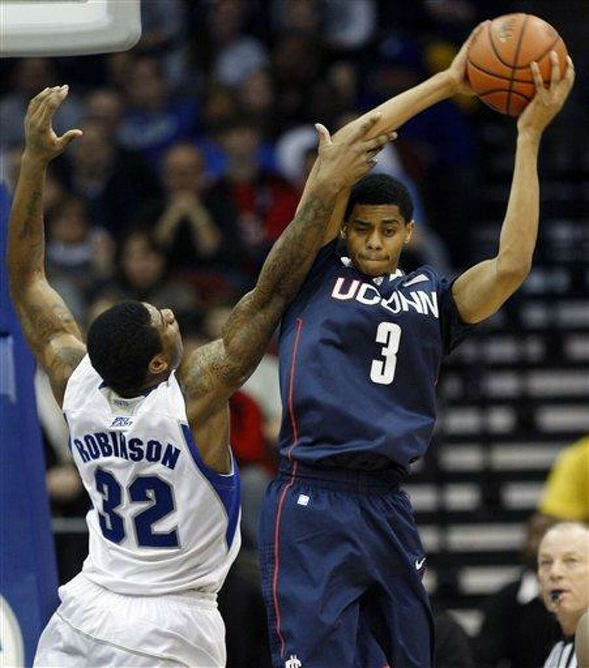 Seton Hall's Jeff Robinson (32) tries to block the path of Connecticut's Jeremy Lamb (3) during the first half of an NCAA college basketball game Saturday, Feb. 5, 2011, in Newark, NJ (AP Photo/Mel Evans)