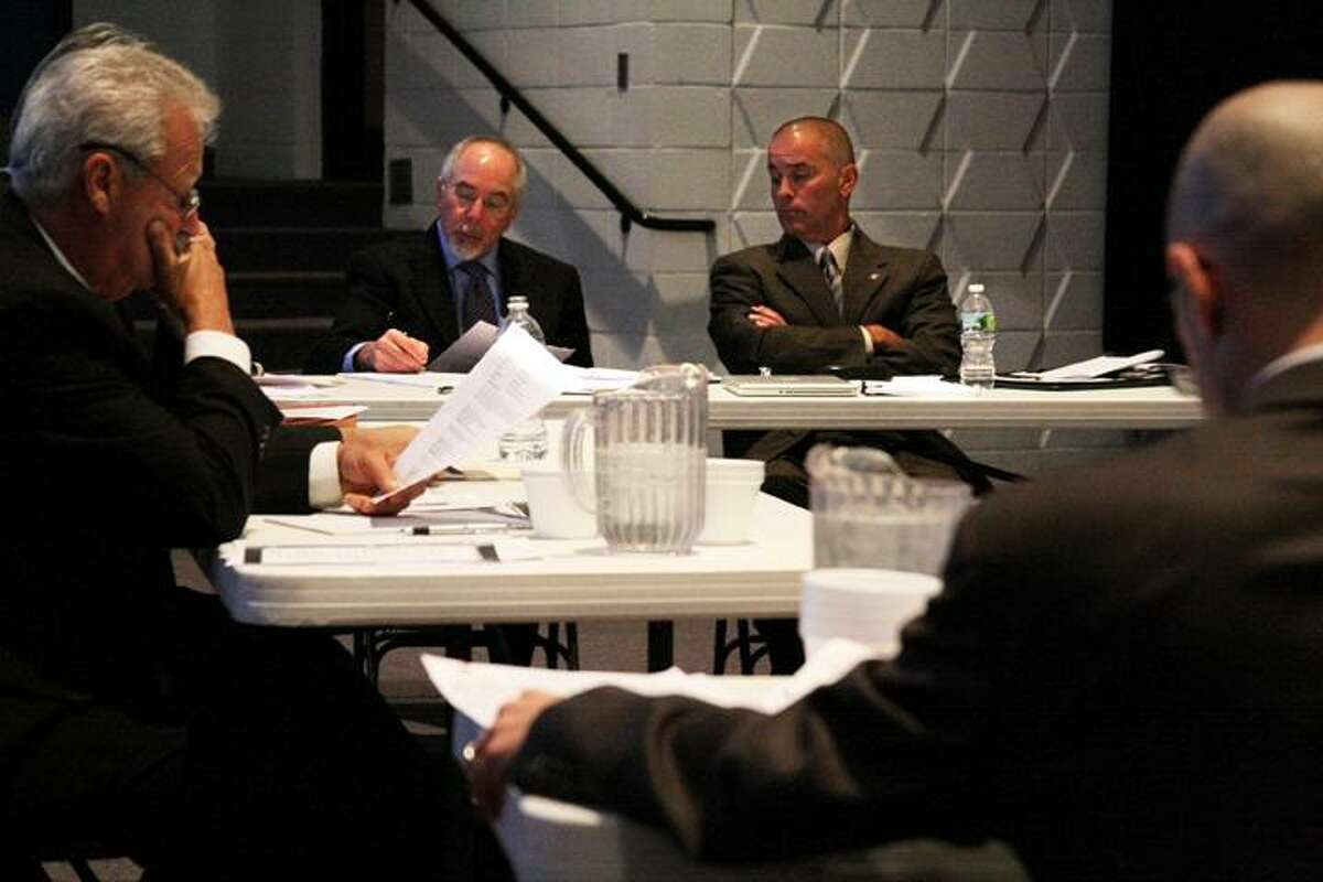 Former East Hampton Police Chief Matthew Reimondo (right) and his lawyer Leon Rosenblatt (left) present their case in front of Robert Drewry, the hearing officer (far left), and Mark Sommaruga (foreground), the lawyer representing the town of East Hampton. Matt Andrew, Special to the Press