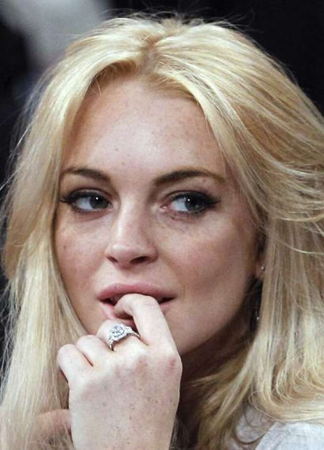 FILE - In this Jan. 9, 2011 file photo, Lindsay Lohan attends the Los Angeles Lakers New York Knicks NBA basketball game in Los Angeles. Los Angeles police say they are investigating Lindsay Lohan for the possible theft of jewelry that was returned after detectives obtained a search warrant. (AP Photo/Alex Gallardo, File) Photo: ASSOCIATED PRESS / AP2011