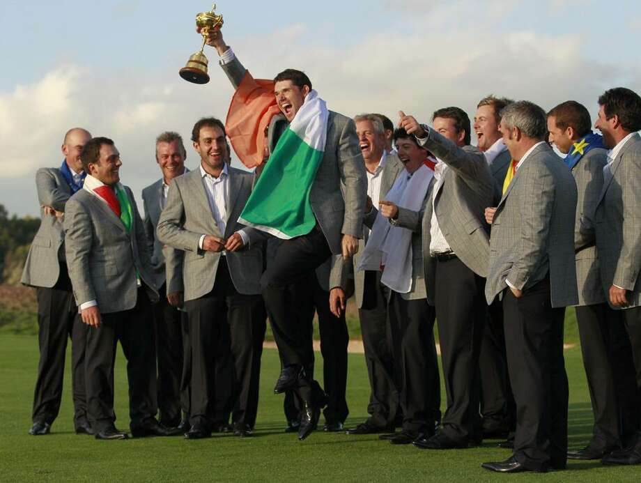 Europe team member Padraig Harrington, surrounded by teammates, holds the trophy after winning the 2010 Ryder Cup golf tournament at the Celtic Manor Resort in Newport, Wales, Monday. (AP Photo/Matt Dunham) Photo: AP / AP
