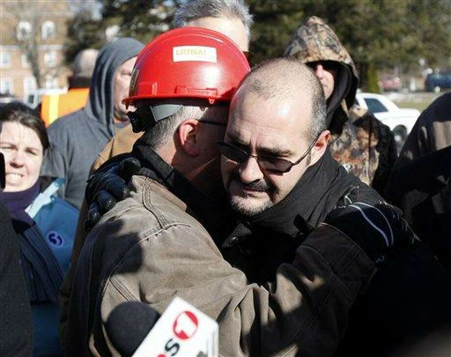 Michael Rosario, business representative for the Plumbers, Pipefitters, & HVAC Local 777, hugs a friend after telling reporters about losing three friends in the explosion at the Kleen Energy Systems power plant on Sunday in Middletown, Conn., Monday, Feb. 8, 2010.  (AP Photo/Seth Wenig) Photo: ASSOCIATED PRESS / AP2010