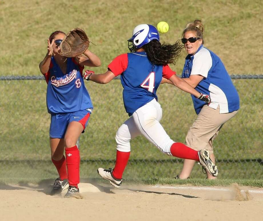 Middletown Press. 06.03.2011. Coginchaug's Mari Handley knocks in Coginchaug's first run in Coginchaug's state quarterfinal softball game against Hale Ray on Friday. Hale Ray won, 7-6. To buy a glossy print of this photo and more, visit www.middletownpress.com / a