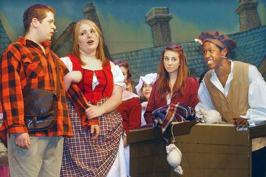 """Middletown High School students, from left, Joey Czaja as Jeff Douglas, April LaRosa as Meg Brock, Michaela Dwyer as a townsperson and Ricky Bailen as Archie Beaton, in dress rehearsal for """"Brigadoon."""" Showtimes are tonight, Friday and Saturday at 7 p.m., with a Sunday matinee at 2 p.m. Tickets are $12 for adults and $8 for students, and can be purchased at the door. The orginal Broadway musical """"Brigadoon"""" opened at the Ziegfeld Theatre March, 13, 1947, and ran for 581 performances. To buy a glossy print of this photo and more, visit <a href=""""http://www.middletownpress.com"""">www.middletownpress.com</a>. (Catherine Avalone"""