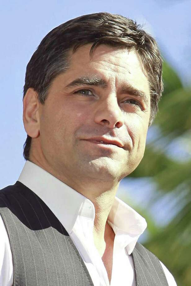 FILE - In a Monday, Nov. 16, 2009 file photo, actor John Stamos is honored with star on the Hollywood Walk of Fame in Los Angeles. Stamos can't make it to federal court in Michigan's Upper Peninsula next week, but he still wants to be heard. Federal prosecutors are asking a judge to allow them to read a statement from Stamos when two people are sentenced Friday Oct. 8, 2010 for trying to extort $680,000 from him.  (AP Photo/Damian Dovarganes, File) Photo: ASSOCIATED PRESS / AP