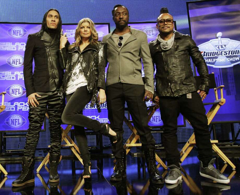 "The Black Eyed Peas Taboo, left to right, Fergie, <a href=""http://Will.i.am"">Will.i.am</a> and <a href=""http://Apl.de"">Apl.de</a>.ap pose for a picture during a news conference at the NFL football Super Bowl XLV Media Center Thursday in Dallas. The Black Eyed Peas are scheduled to perform at halftime of Super Bowl XLV.(AP Photo/David J. Phillip) Photo: ASSOCIATED PRESS / AP2011"