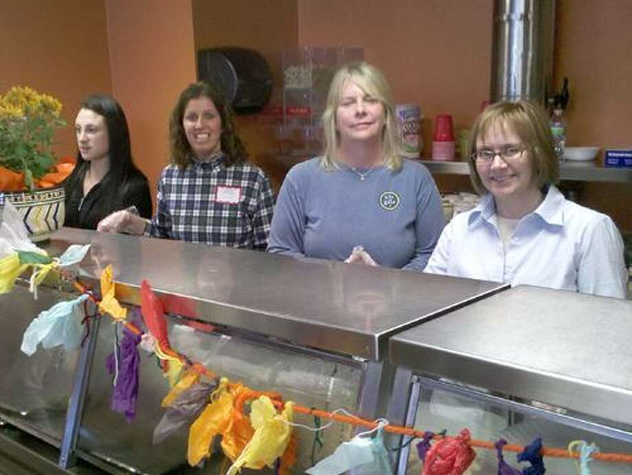 Jim Salemi I The Middletown Press From left, are Kate Stanley of Middletown; Kathy Burns of Middletown; Sandra Mahan of Chester; and Rebecca Bordonaro of Portland, all volunteers at St. Vincent de Paul soup kitchen in Middletown on Thanksgiving Day.