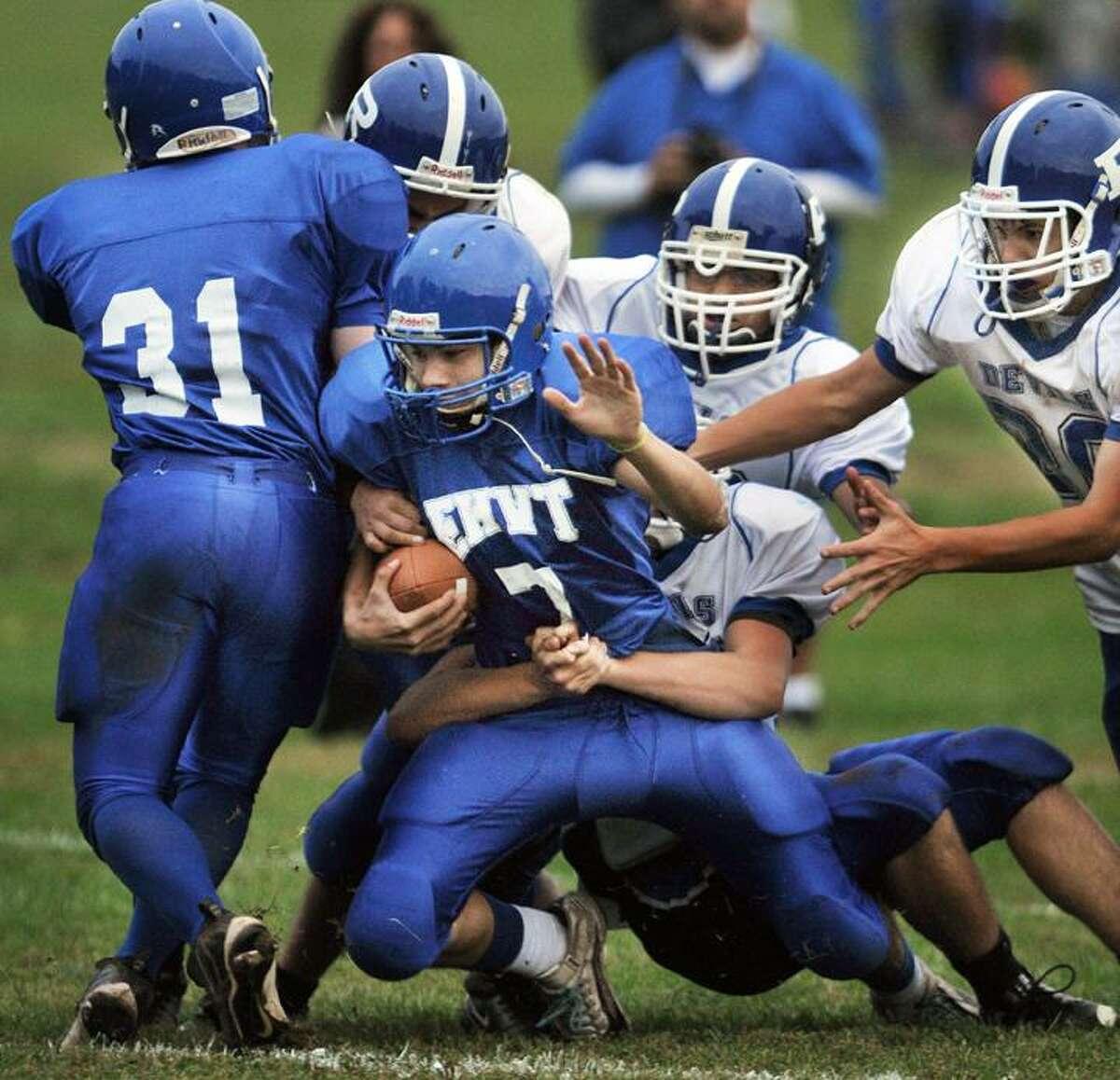 The Plainville Devils defense sacks East Hampton-Vinal quarterback Spencer Daly Monday at Vinal Tech High School. (Catherine Avalone