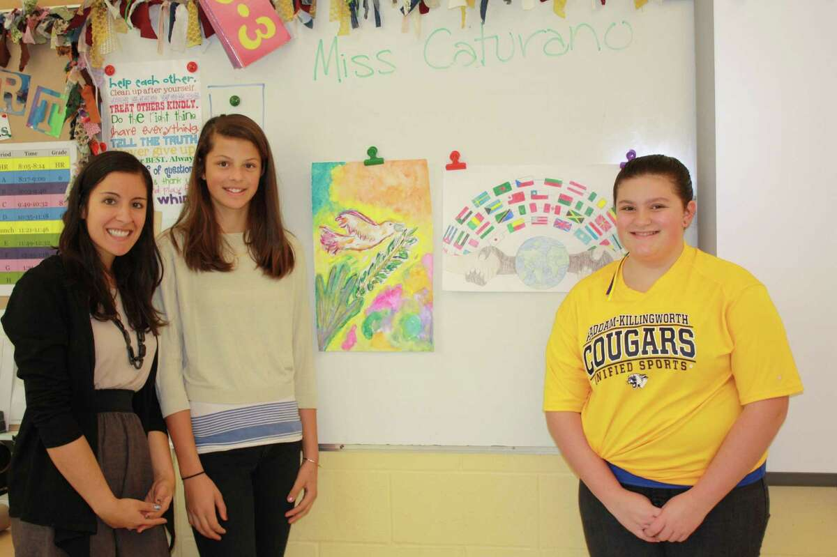 Left to right are HKMS art teacher Jill Caturano, winner Clementine Wurzbach and runner-up Dominique DeLuca with their winning Peace Posters.