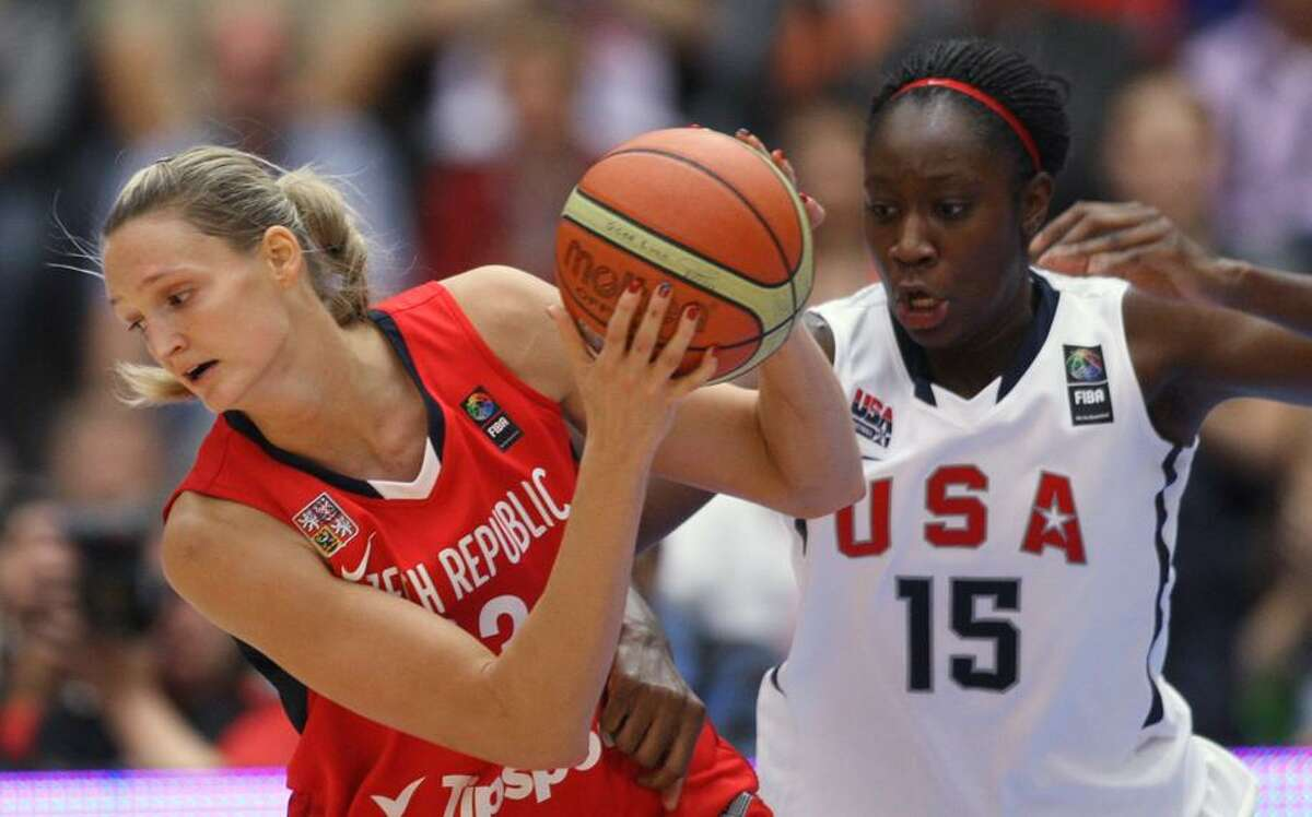 Petra Kulichova, left, from Czech Republic guarded by Tina Charles, right, from U.S. during their World Basketball Championship gold medal match in Karlovy Vary, Czech Republic, Sunday. (AP Photo/Petr David Josek)