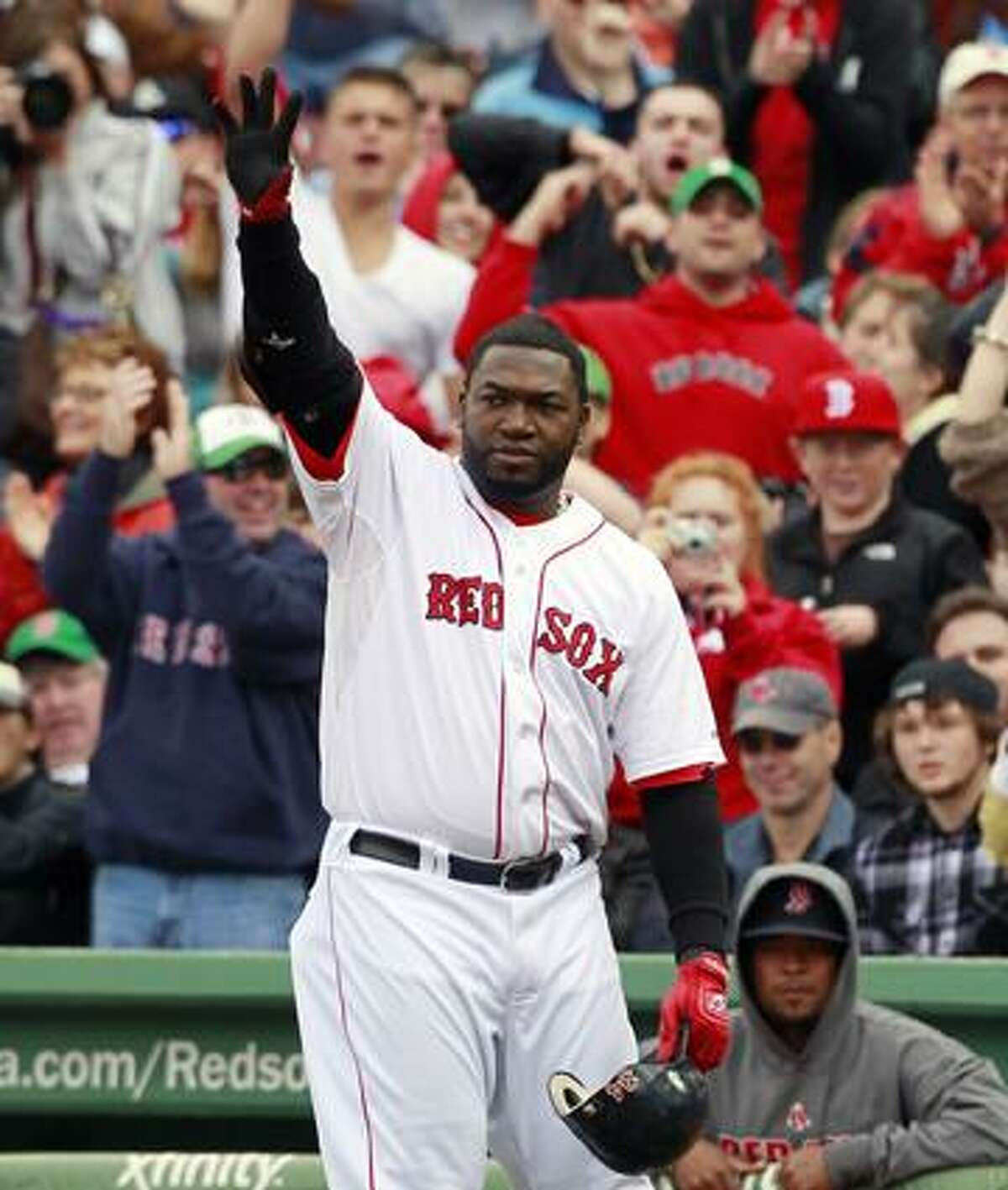 Boston Red Sox's David Ortiz waves to the crowd as he leaves a baseball game against the New York Yankees in the sixth inning, Sunday in Boston. (AP Photo/Michael Dwyer)