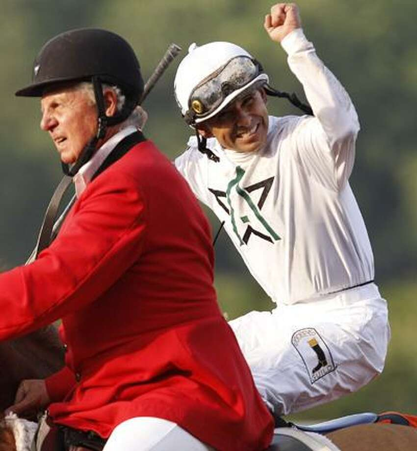 Jockey Mike Smith, right, celebrates after riding Drosselmeyer to win the 142nd running of the Belmont Stakes at Belmont Park in Elmont, N.Y., Saturday, June 5, 2010. (AP Photo/Kathy Willens) Photo: AP / AP
