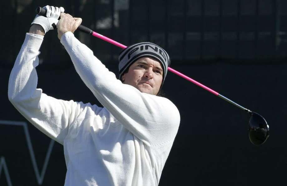 AP  Bubba Watson hits his tee shot on the first hole during the first round of the Waste Management Phoenix Open PGA golf tournament Thursday in Scottsdale, Ariz.