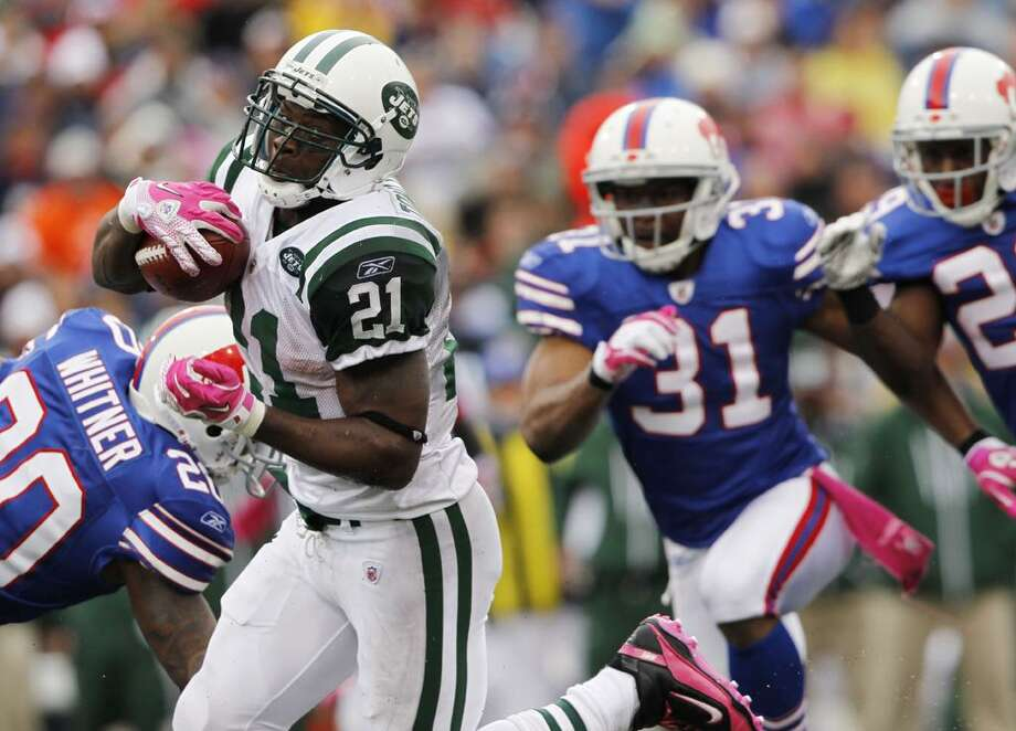New York Jets running back LaDainian Tomlinson (21) runs for a touchdown past Buffalo Bills defenders Donte Whitner (20), Jairus Byrd (31) and Drayton Florence during the second half of an NFL football game in Orchard Park, N.Y., Sunday. The Jets won 38-14.  (AP Photo/Mike Groll) Photo: AP / AP