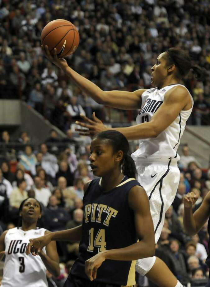 AP Connecticut's Maya Moore, top, goes up for a shot over Pittsburgh's Jania Sims in the second half of an NCAA women's college basketball game at Storrs, Conn., Saturday, Jan. 22. UConn defeated Pittsburgh 66-46.