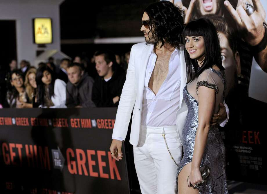 """Russell Brand, left, a cast member in """"Get Him to the Greek,"""" poses with his fiancee, singer Katy Perry, at the premiere of the film at the Greek Theater in Los Angeles, Tuesday, May 25, 2010. (AP) Photo: AP / AP"""