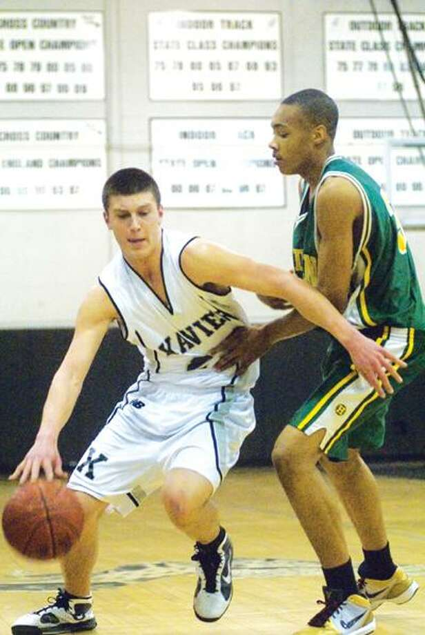Xavier's Mike Boornazian dribbles around Hamden's Ryan Vilmont Tuesday night during a Class LL first round game. (Max Steinmetz / Special to the Press)