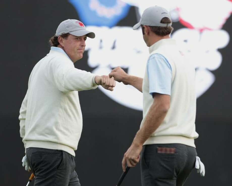 U.S. team members Phil Mickelson, left, and Dustin Johnson react on the 10th green during the 2010 Ryder Cup golf tournament at the Celtic Manor golf course in Newport, Wales, Friday. (AP Photo/Matt Dunham) Photo: AP / AP