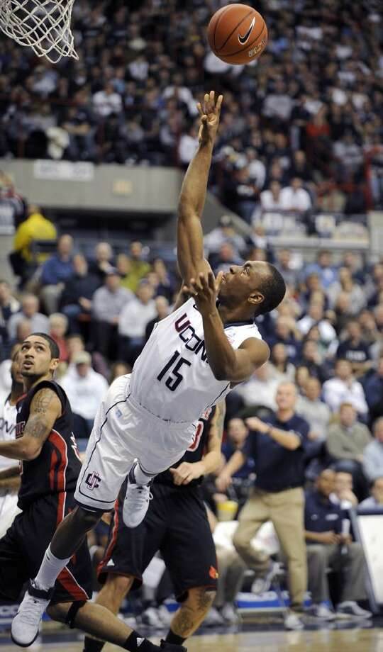 Connecticut's Kemba Walker shoots during the second half of his their 79-78 double overtime loss to Louisville in an NCAA college basketball game in Hartford, Conn., on Saturday, Jan. 29, 2011. Walker scored 20 points in the loss. (AP Photo/Fred Beckham)