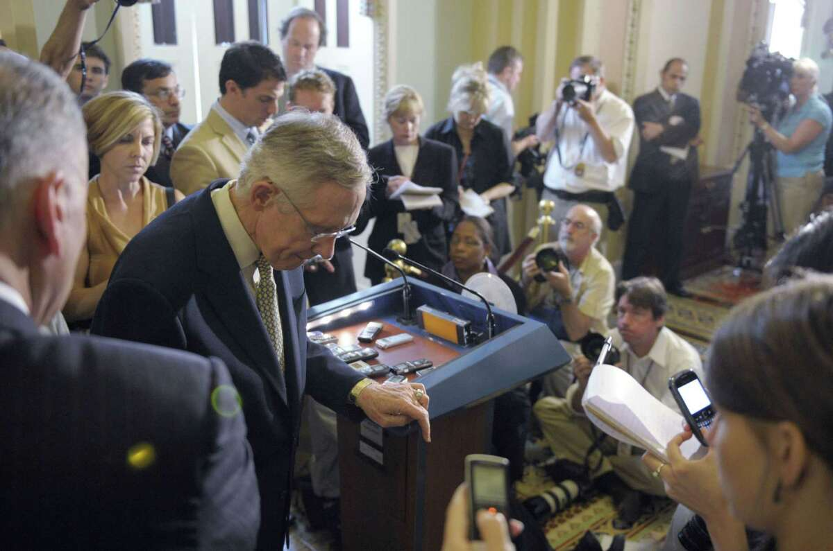 Senate Majority Leader Harry Reid of Nev., steps away from the microphone after speaking to reporters during a news conference on Capitol Hill in Washington, Friday, July 29, 2011. (AP Photo/Susan Walsh)