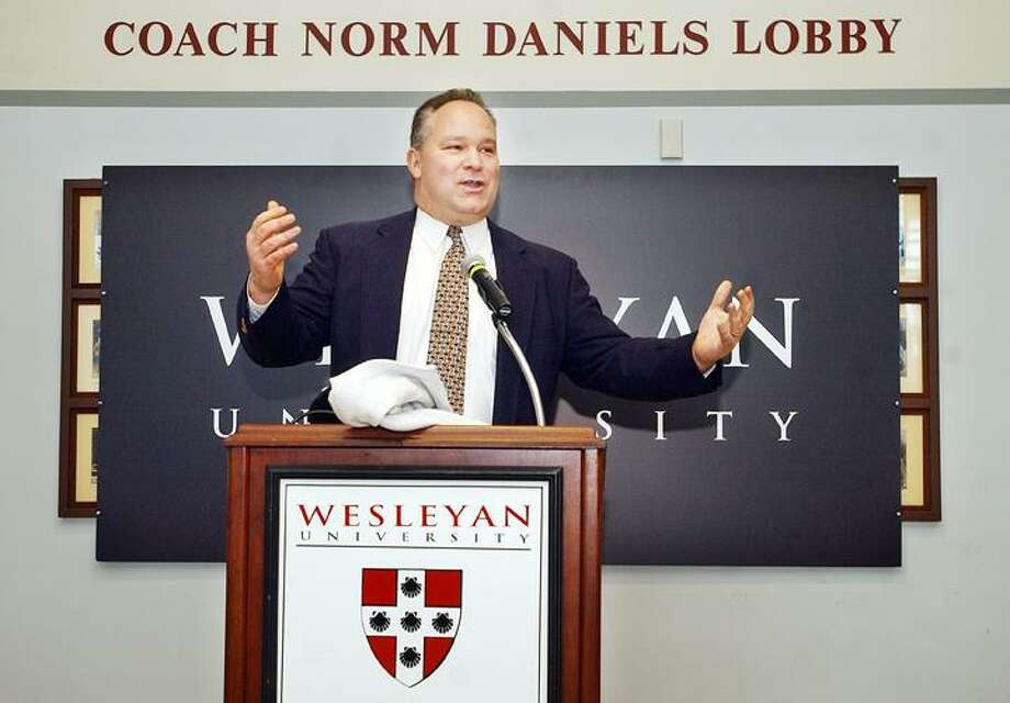 Wesleyan's new head football coach, Mike Whalen, speaks at a press conference at the Norm Daniel Lobby in Freeman Athletic Center Monday. Whalen, a Wesleyan alum, is the former head football coach of rival Williams College. (Catherine Avalone / The Middletown Press)