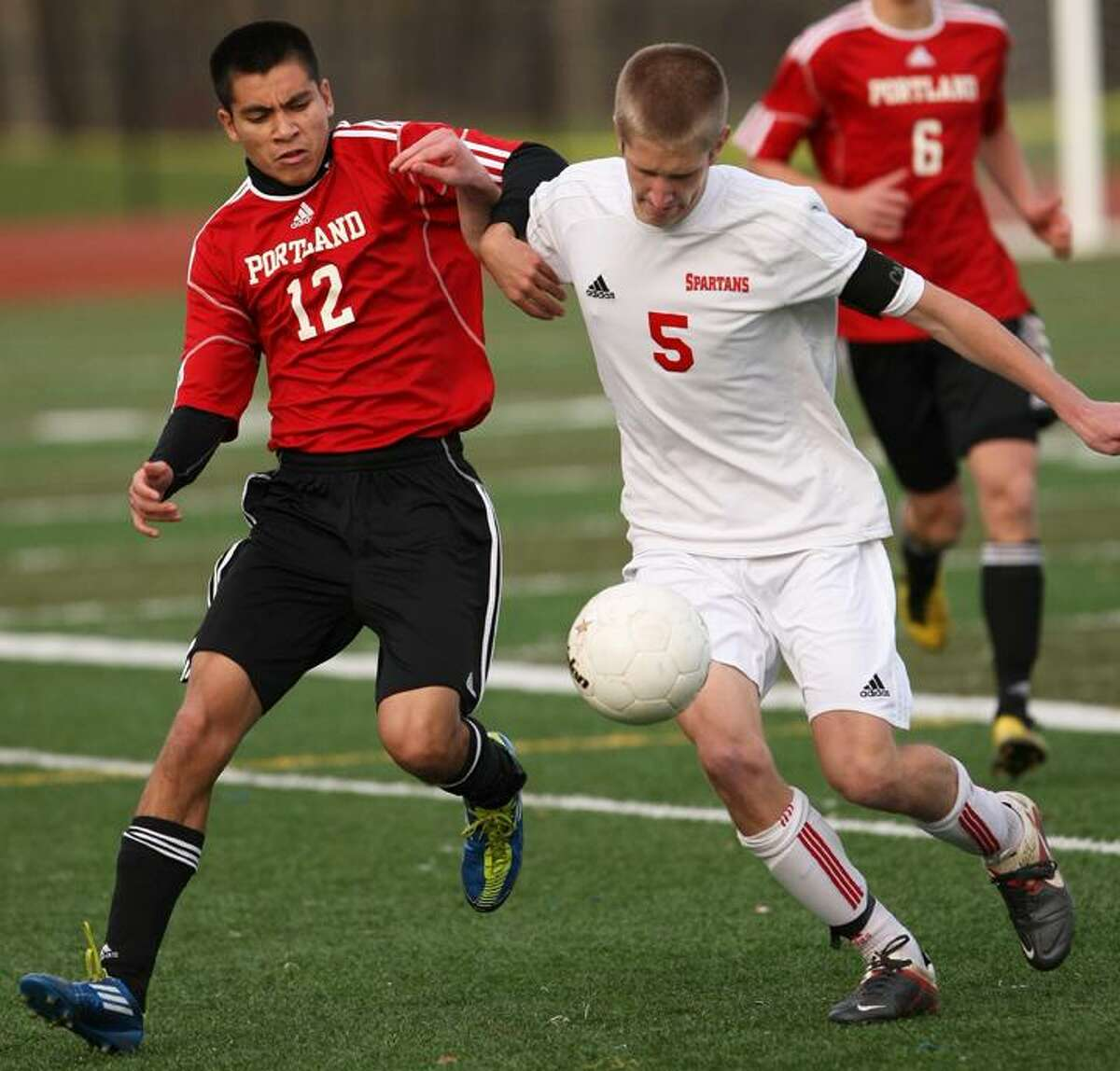 Special to the Press 11.19.11. Portland's Jesse Petrini battles Somers' Don Whittle in Saturday's class S semifinal soccer game. Somers won, 3-1. To buy a glossy print of this photo and more, visit www.middletownpress.com