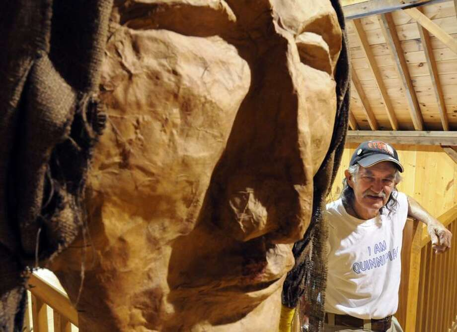 """Gordon """"Fox Running"""" Brainerd has assembled a collection of Native American artifacts and art, including this papier-mache head by an area art class, for his Quinnipiac Dawnland Museum out at the Dudley Farm in Guilford. (Mara Lavitt/Journal Register News Service photos)"""