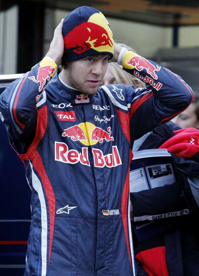 AP Germany's Red Bull Formula One driver World Champion 2010 Sebastian Vettel adjusts his hat during the official presentation of the Red Bull Formula One Team 2011 at the Ricardo Tormo race track in Cheste, just outside Valencia Spain, Tuesday.
