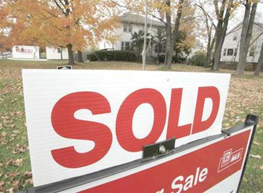 In this photo take Oct. 26, 2010, a sold sign is displayed outside a house in Mayfield Hts., Ohio. Home prices are falling faster in the nation's largest cities, and a record number of foreclosures are expected to push prices down further through next year. (AP Photo/Amy Sancetta) Photo: AP / AP
