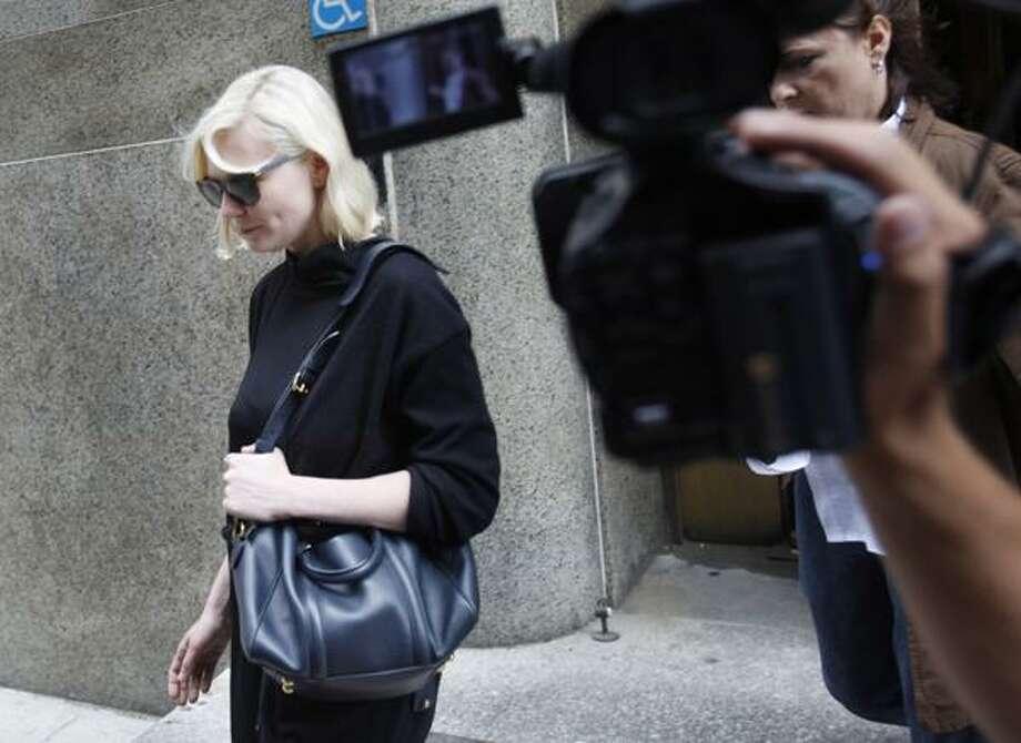 Actress Kirsten Dunst exits Manhattan criminal court in New York, Tuesday. (AP) Photo: AP / AP