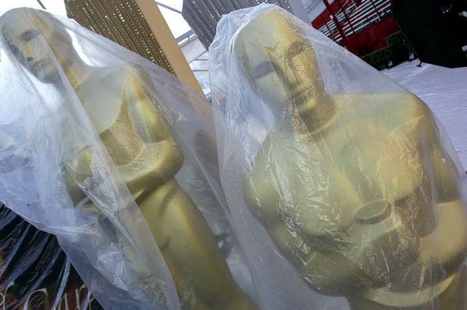 Oscar statues wrapped in plastic stand along the red carpet outside the Kodak Theatre in preparation for the 82nd Academy Awards in Los Angeles, Calif., Thursday. The Academy Awards will be held on Sunday. (AP) Photo: AP / AP