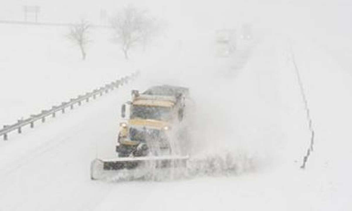 A snow plow makes its way eastbound on I-70 Tuesday, Feb. 1, 2011, near Boonville. Mo. More snow is expected to accumilate throughout the day. (AP Photo/L.G. Patterson)