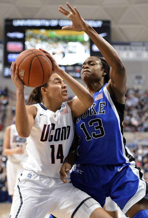 Connecticut's Bria Hartley, left, drives to the basket while guarded by Duke's Karima Christmas during the first half of an NCAA college basketball game in Storrs, Conn., Monday, Jan. 31, 2011. (AP Photo/Jessica Hill) / AP2011