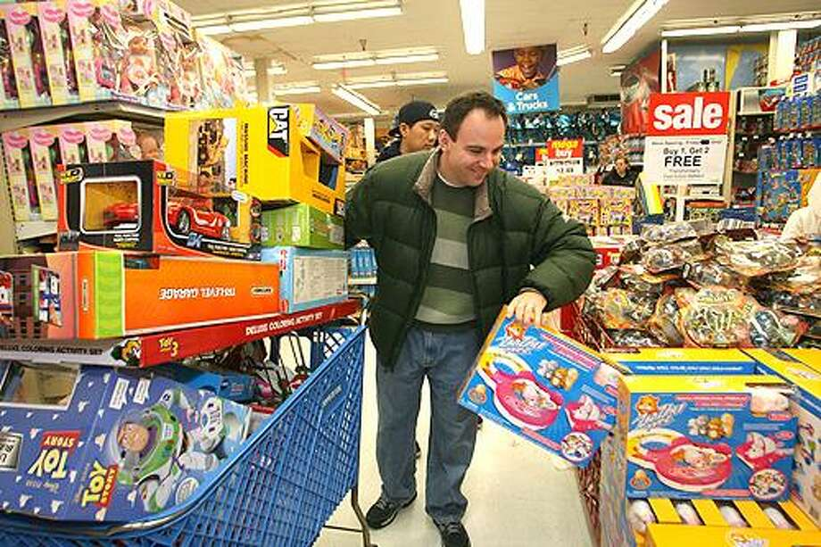 James Hept of Ridgewood, N.J. shops at a Toys R Us store in Paramus, N.J. on Friday, Nov. 26, 2010. (AP Photo/The Record of Bergen County, Elizabeth Lara) ONLINE OUT; MAGS OUT; TV OUT; INTERNET OUT; NO SALES; NO ARCHIVING; MANDATORY CREDIT Photo: ASSOCIATED PRESS / The Record of Bergen County
