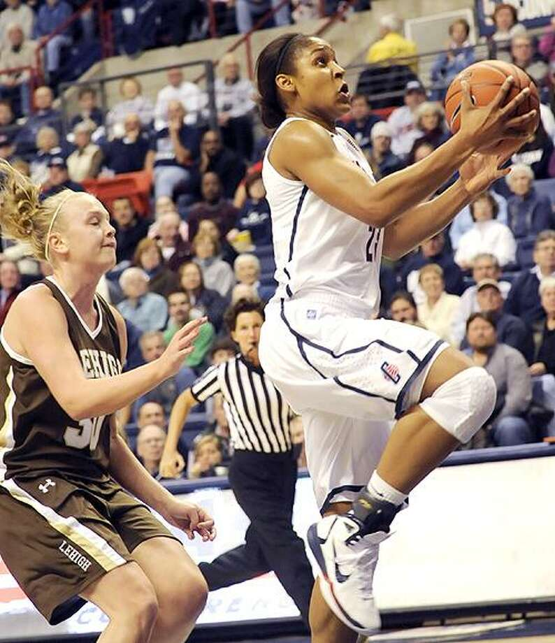 Connecticut's Maya Moore, right, goes up for a shot past Lehigh's Courtney Dentler in the first half of an NCAA college basketball game at Storrs, Conn., Saturday, Nov. 27, 2010.  (AP Photo/Bob Child) Photo: ASSOCIATED PRESS / FR170410 AP