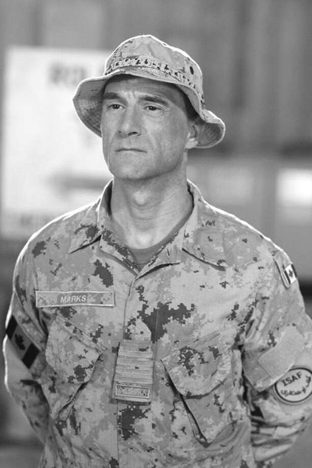 """Col. Marks (Elias Koteas) can't help but acknowledge Lady Luck when an entire unit survives their injuries without complications, something they attribute to their own lucky charm, a private, on """"Combat Hospital,"""" at 10 p.m. on ABC. Photo: ABC / © 2011 American Broadcasting Companies, Inc. All Rights Reserved"""