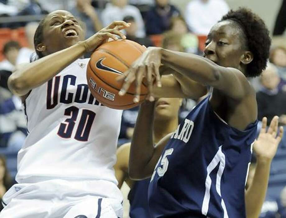 Connecticut's Lorin Dixon, left, and Howard's Julee' O'Neal battle for a rebound during the second half of an NCAA college basketball game at Storrs, Conn., Friday, Nov. 26, 2010. No. 1 UConn defeated Howard 86-25. (AP Photo/Bob Child) Photo: AP / FRE 170410 AP