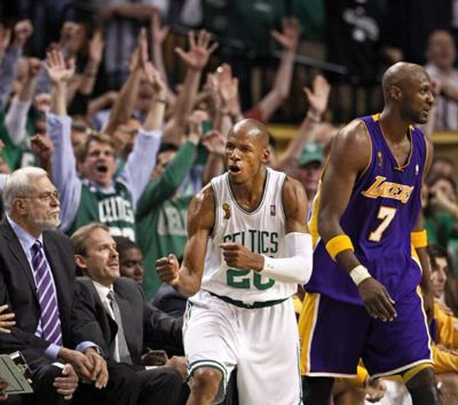 In this June 17, 2008 file photo, Boston Celtics' Ray Allen celebrates a three-point shot in front of Los Angeles Lakers' Lamar Odom (7) and Lakers coach Phil Jackson, left, during the fourth quarter of Game 6 of the NBA finals in Boston. The Celtics face the Lakers in Game 1 in a rematch of the NBA finals on Thursday. (AP) Photo: ASSOCIATED PRESS / AP2008