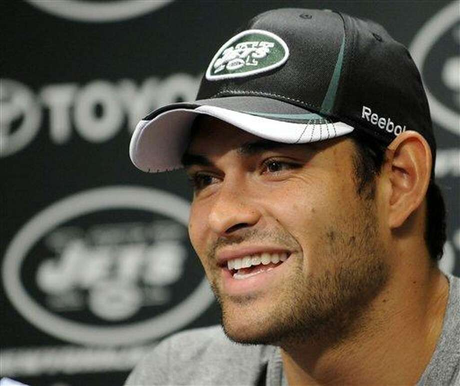 New York Jets quarterback Mark Sanchez speaks to the media during a news conference at the team's football practice facility Tuesday, July 26, 2011 in Florham Park, N.J., the day after the NFL lockout ended. (AP Photo/Bill Kostroun) Photo: ASSOCIATED PRESS / AP2011