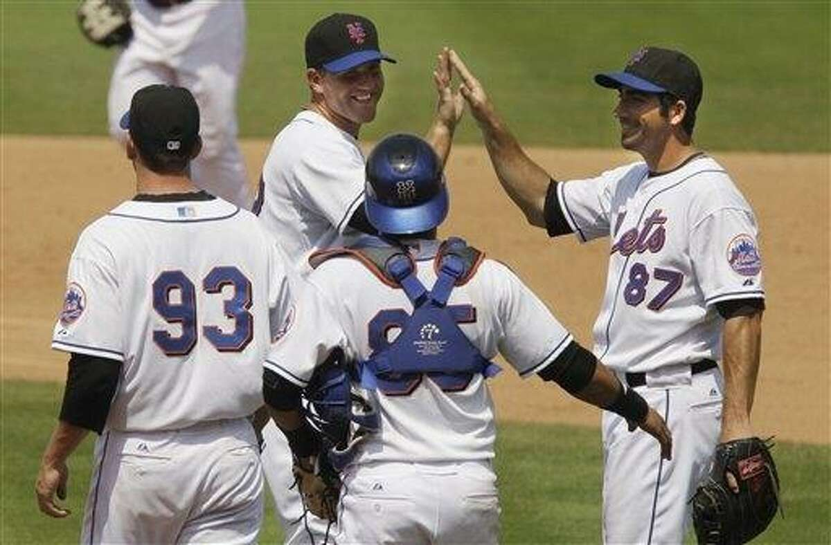 The New York Mets celebrate their 6-3 over the Florida Marlins after a spring training baseball game, Wednesday, March 30, 2011 in Port St. Lucie, Fla. (AP Photo/Carlos Osorio)