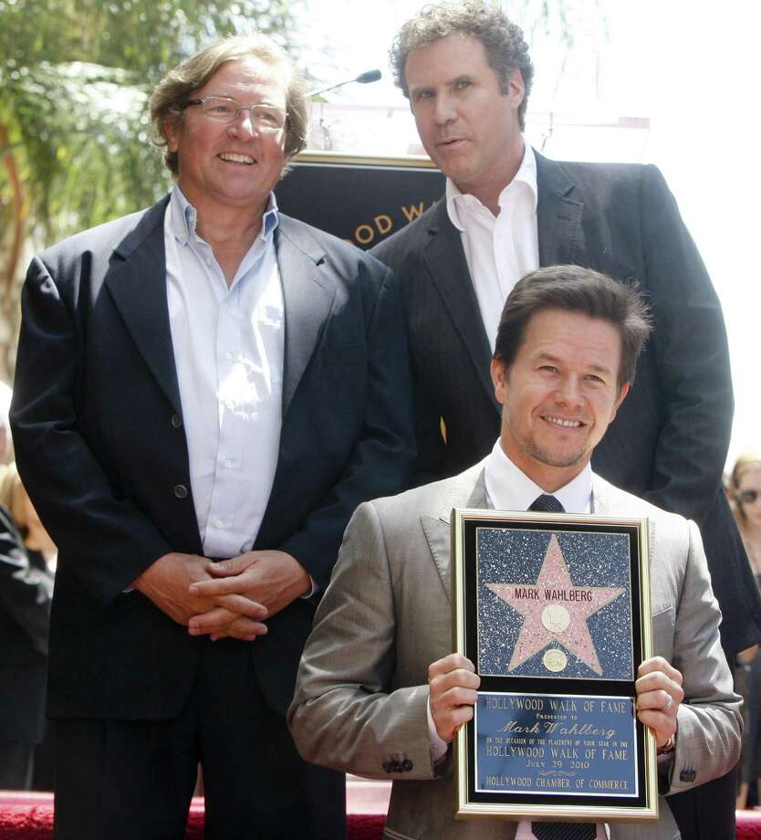 Actor and producer Mark Wahlberg, bottom right, is seen with actor Will Ferrel, top right,  and Producer Lorenzo di Bonaventura as Wahlberg receives a star on the Hollywood Walk of Fame Thursday, July 29, 2010 in Los Angeles. (AP Photo/ Bret Hartman) Photo: AP / FR139655 AP