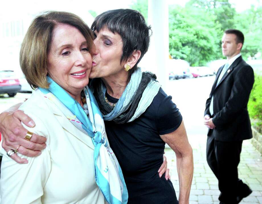 House Minority Leader Nancy Pelosi, left, is kissed by Congresswoman Rosa DeLauro as she leaves a fundraiser for DeLauro at Il Salice banquet hall Sunday in East Haven. Arnold Gold/Register