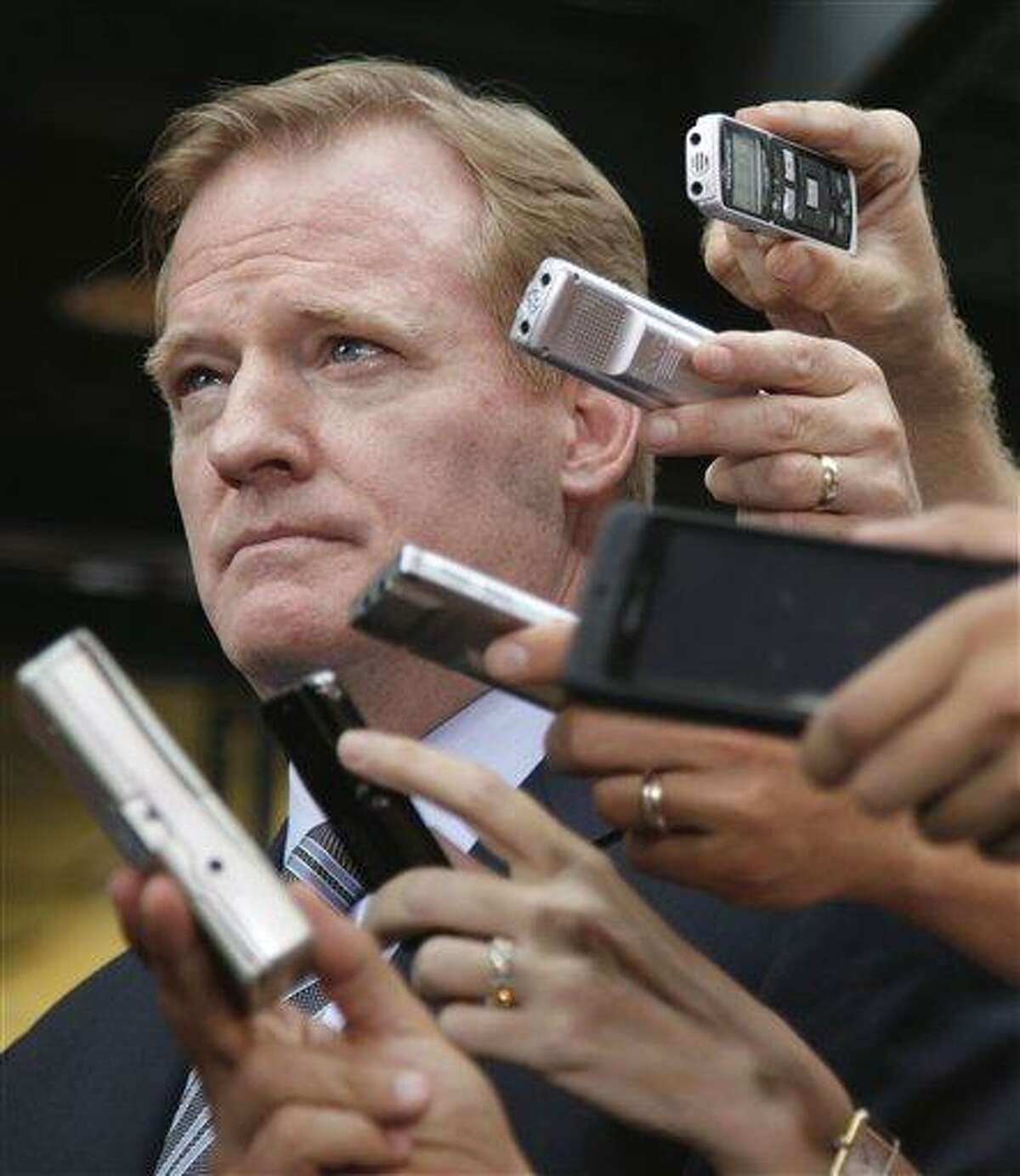 NFL football Commissioner Roger Goodell participates in a news conference at the NFL Players Association in Washington, Monday, July 25, 2011, after the NFL Players Association executive board and 32 team reps voted unanimously Monday to approve the terms of a deal with owners to the end the 4½-month lockout. (AP Photo/Carolyn Kaster)