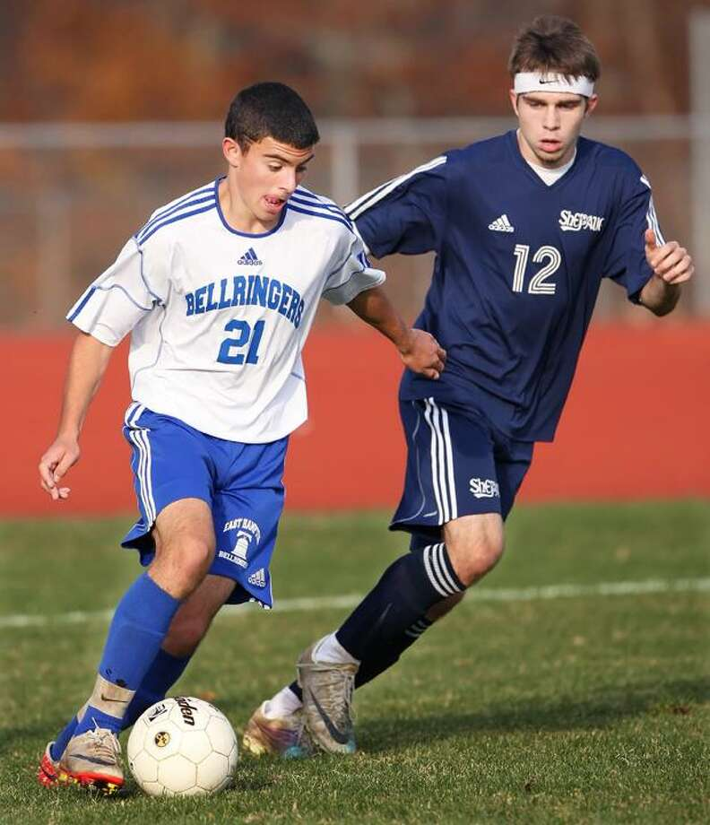 Special to the Press  11.14.11. East HamptonÕs Will Lambert slows  Shepaug ValleyÕs Eddie Kelly in MondayÕs boys soccer game. East Hampton won, 6-2. To buy a glossy print of this photo and more, visit www.middletownpress.com / a