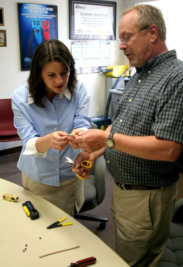 Submitted photo Carpino tries out Ripley tools with Jeffery Smith, director of engineering and technology engineering.