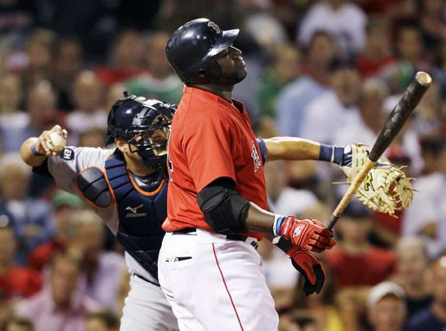 Boston Red Sox designated hitter David Ortiz reacts as he strikes out for the third time against the Detroit Tigers during the eighth inning of their baseball game in Boston, Friday. Ortiz later hit a grand slam in the ninth that put the Sox one run back with one out. They failed to produce another run and lost, 6-5. At rear is Tigers catcher Gerald Laird. (AP Photo/Charles Krupa) Photo: AP / AP