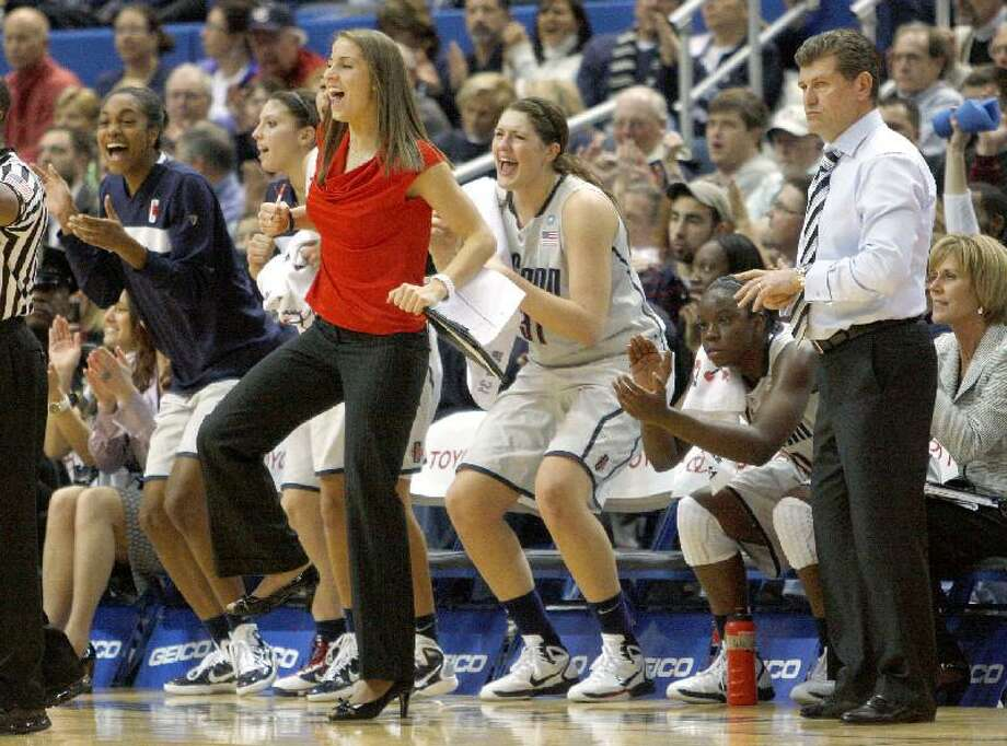 ASSOCIATED PRESS UConn's Caroline Doty (red shirt) celebrates her team's record-setting 89th straight win on Dec. 21, 2010 against Florida State. Doty returns to the team today for the season opener against Holy Cross.