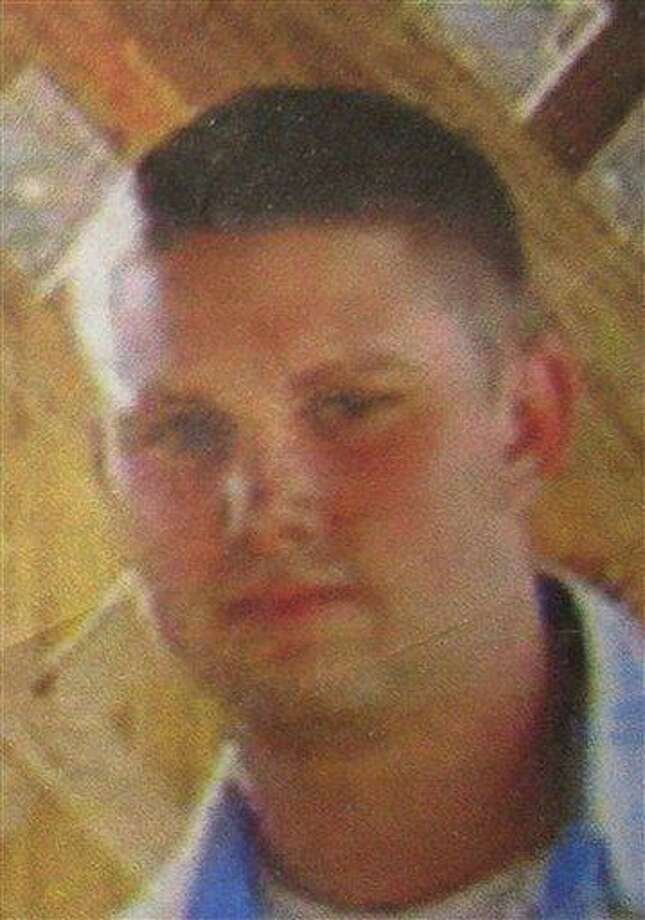 """This photo, displayed on a leaflet that was distributed by the U.S. military to civilians in Logar province, east of Kabul, Afghanistan, on July 25, 2010  shows a missing U.S. Navy sailor. The Navy identified the missing sailor as Petty Officer 3rd Class Jarod Newlove, a 25-year-old from the Seattle area. The Pentagon lists Newlove as """"whereabouts unknown,"""" and did not confirm he was captured. Another service member who went missing with Newlove was identified as Petty Officer 2nd Class Justin McNeley _ a 30-year-old father of two from Wheatridge, Colorado. NATO recovered his body Sunday. (AP Photo) NO SALES Photo: AP / Copyright 2010 The Associated Press. All rights reserved. This material may not be published, broadcast, rewritten or redistributed."""