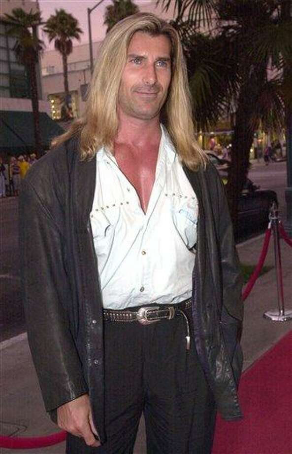 """In this Aug. 28, 2000 file photo, actor and model Fabio arrives in Santa Monica, Calif., for the premiere of """"My 5 Wives."""" Italian model Fabio is trying to muscle in on Isaiah Mustafa as the front man for Procter & Gamble Co.'s Old Spice line of men's body wash and deodorant. (AP Photo/Kim D. Johnson, file) Photo: AP / AP2000"""